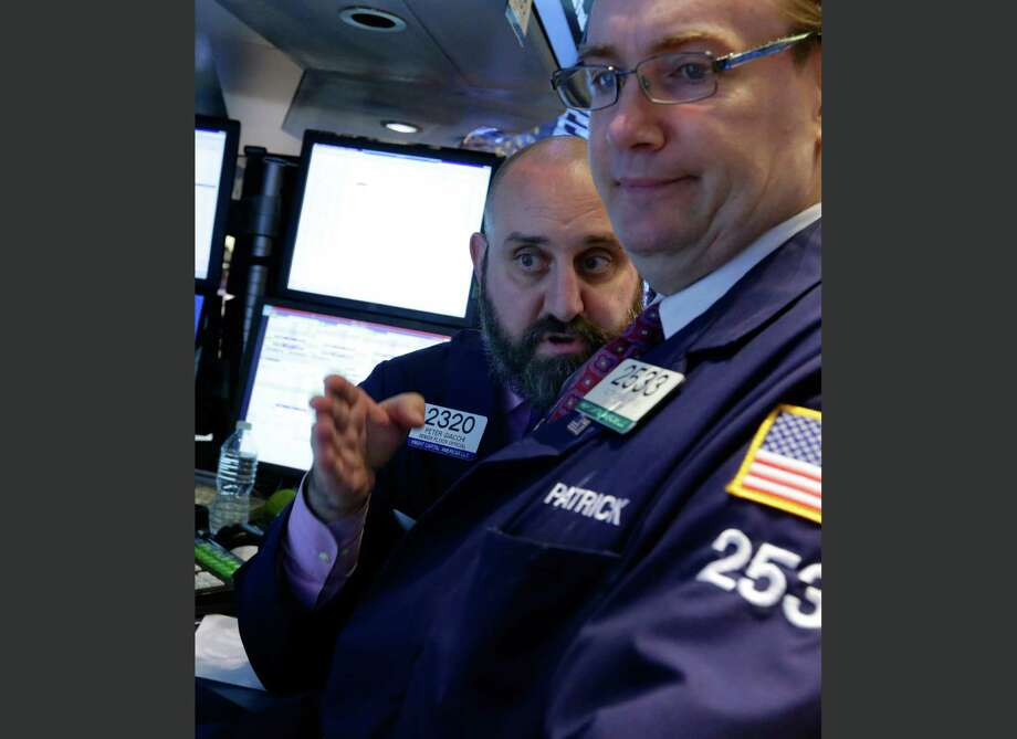 In this Wednesday, Oct. 9, 2013 photo, specialists Peter Giacchi, left, and Patrick King confer at a trading post on the floor of the New York Stock Exchange. After a strong finish on Friday, investors are hoping the stock market rally will continue Monday, Oct. 28, 2013.   (AP Photo/Richard Drew) ORG XMIT: NY108 Photo: Richard Drew / AP