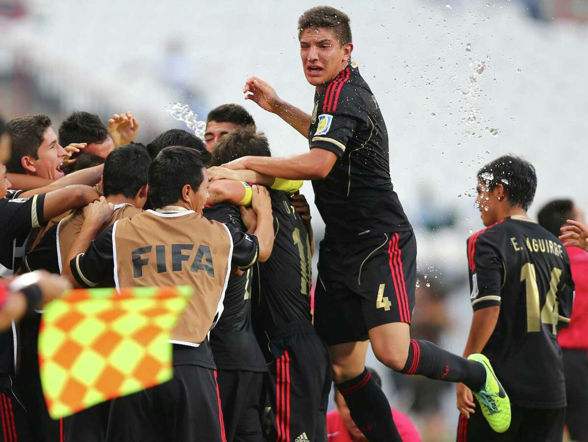 Players of Mexico jubilate after scoring a goal against Italy during their game in the round 16 of the FIFA U-17 World Cup at Mohammad Bin Zayed Stadium in Abu Dhabi, on October 28, 2013.