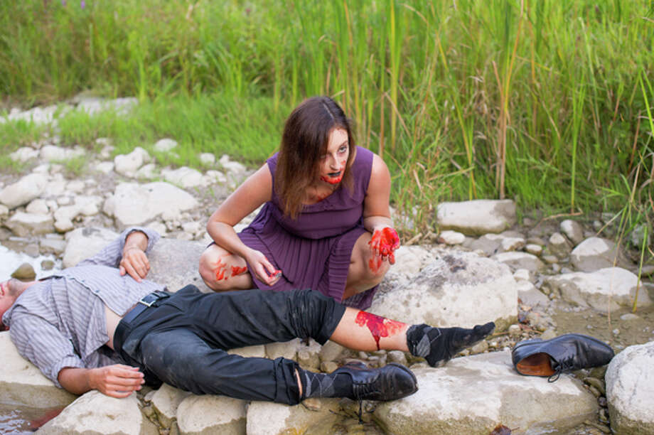 Holly Young and Harlan Guthrie's zombie themed engagement photos. Photo: Photography By Alex Lee,  Www.younghearts.ca