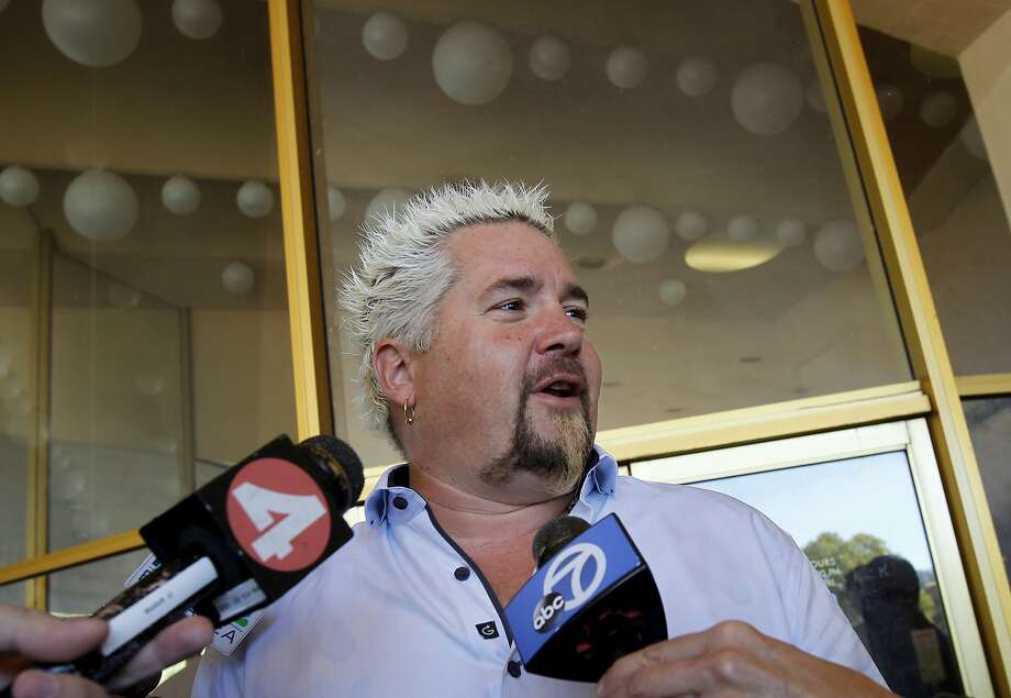 Guy Fieri spoke briefly with reporters after his testimony in San Rafael, Calif Monday October 28, 2013. Celebrity chef Guy Fieri testified at the trial of alleged Lamborghini thief and attempted murderer Max Wade. Photo: Brant Ward, The Chronicle
