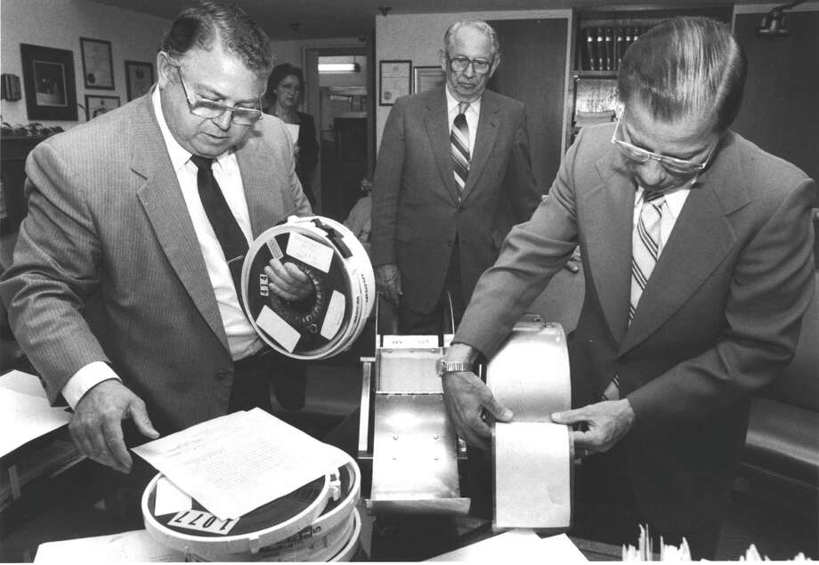 In 1984, then-Harris County District Clerk Ray Hardy, from left, Tax Assessor-Collector Carl Smith and state District Judge Shearn Smith installed new randomizing tapes in the jury wheel. Photo: Carrie Beth Tucker, HC Staff / Houston Chronicle