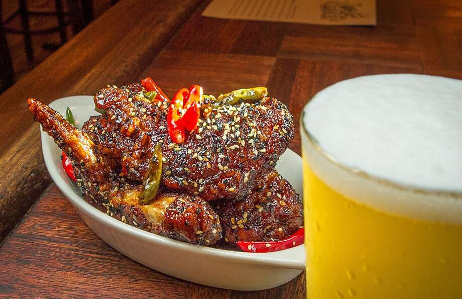 Sweet Lou's Bangkok Wings ($10) are coated in sweet and spicy Chinese black vinegar and Thai bird chile sauce. Photo: John Storey, Special To The Chronicle