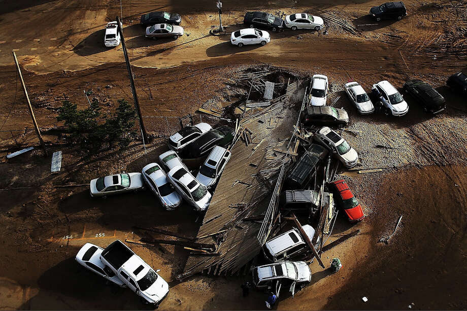 Abandoned and flooded cars are sit after Hurricane Sandy on November 2, 2012 in the Rockaway neighborhood, of the Queens borough of New York City. Photo: Spencer Platt, Getty Images / 2013 Getty Images