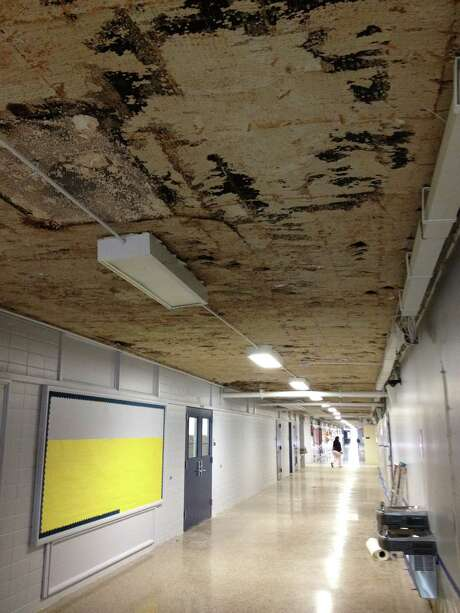 School board member Juliet Stipeche took this photo at the Rusk School after a major rainstorm hit in late September. The black spots on the ceiling show severe water damage. Parents had complained for years that the roof leaked regularly and needed to be replaced.