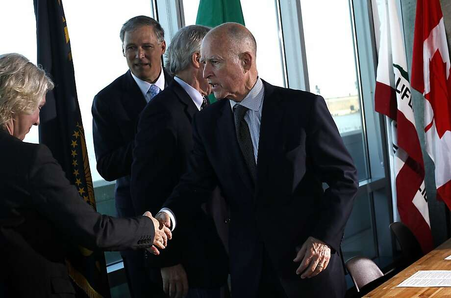 Gov. Jerry Brown shakes hands after signing a climate-change agreement with the governors of Washington and Oregon and the British Columbia minister of environment in San Francisco. Photo: Sarah Rice, Special To The Chronicle