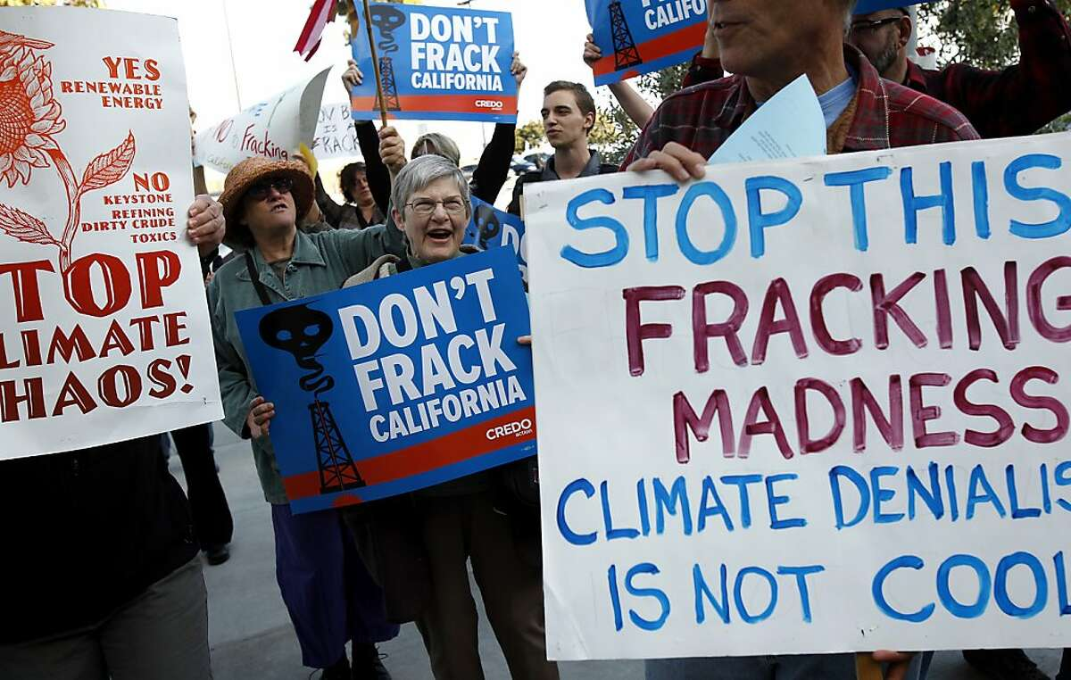 People protest outside where Governor Jerry Brown signed a climate change agreement with the governors of Oregon, Washington and the British Columbia Minister of the Environment in San Francisco, Calif., on Monday, October 28, 2013.