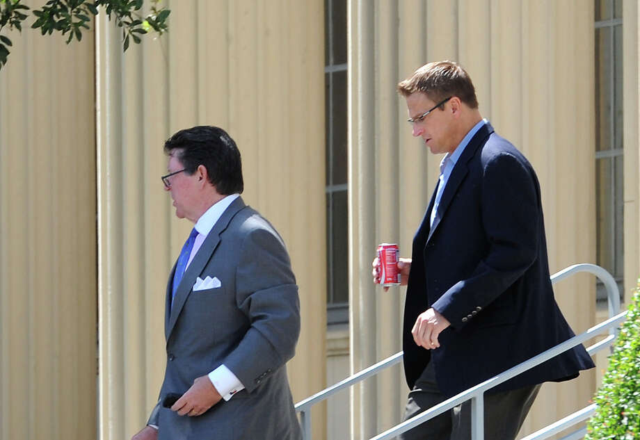 Matthew Bowman, right, former owner of Port Arthur Environmental Services, leaves the federal courthouse Monday. Photo: Guiseppe Barranco, STAFF PHOTOGRAPHER / The Beaumont Enterprise