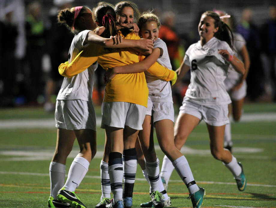 The Wilton girls celebrate their 1-0 win over Westhill after the FCIAC semifinal game at Norwalk High School in Norwalk, Conn., on Monday, Oct. 28, 2013. Photo: Jason Rearick / Stamford Advocate