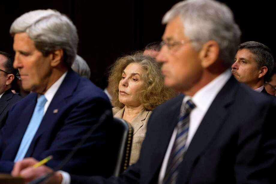 "FILE - In a Tuesday, Sept. 3, 2013 file photo, Teresa Heinz Kerry, center, wife of Secretary of State John Kerry, left, attends a Senate Foreign Relations Committee hearing on Syria on Capitol Hill in Washington, her first public appearance since suffering a seizure in July. Teresa Heinz Kerry has made a ""miraculous"" recovery from seizures in July that her doctors believe are the residual effects of a concussion she suffered in 2009, according to a Monday, Oct. 28, 2013 article in the Pittsburgh Post-Gazette. The ketchup heiress and wife of Secretary of State John Kerry spoke to the Pittsburgh Post-Gazette  when she returned to Pittsburgh on Friday, Oct. 25, 2013. (AP Photo/Jacquelyn Martin, File) ORG XMIT: NY110 Photo: Jacquelyn Martin / AP"