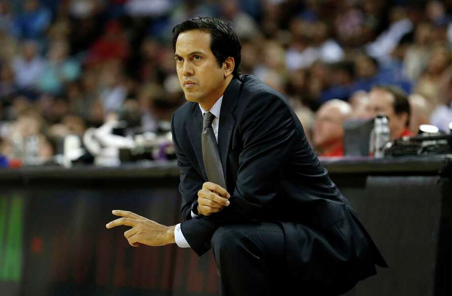 Miami Heat head coach Erik Spoelstra watches the action against the New Orleans Pelicans in the first half of a preseason NBA basketball game in New Orleans, Wednesday, Oct. 23, 2013. (AP Photo/Bill Haber) ORG XMIT: LAWH103 Photo: Bill Haber / FR170136 AP