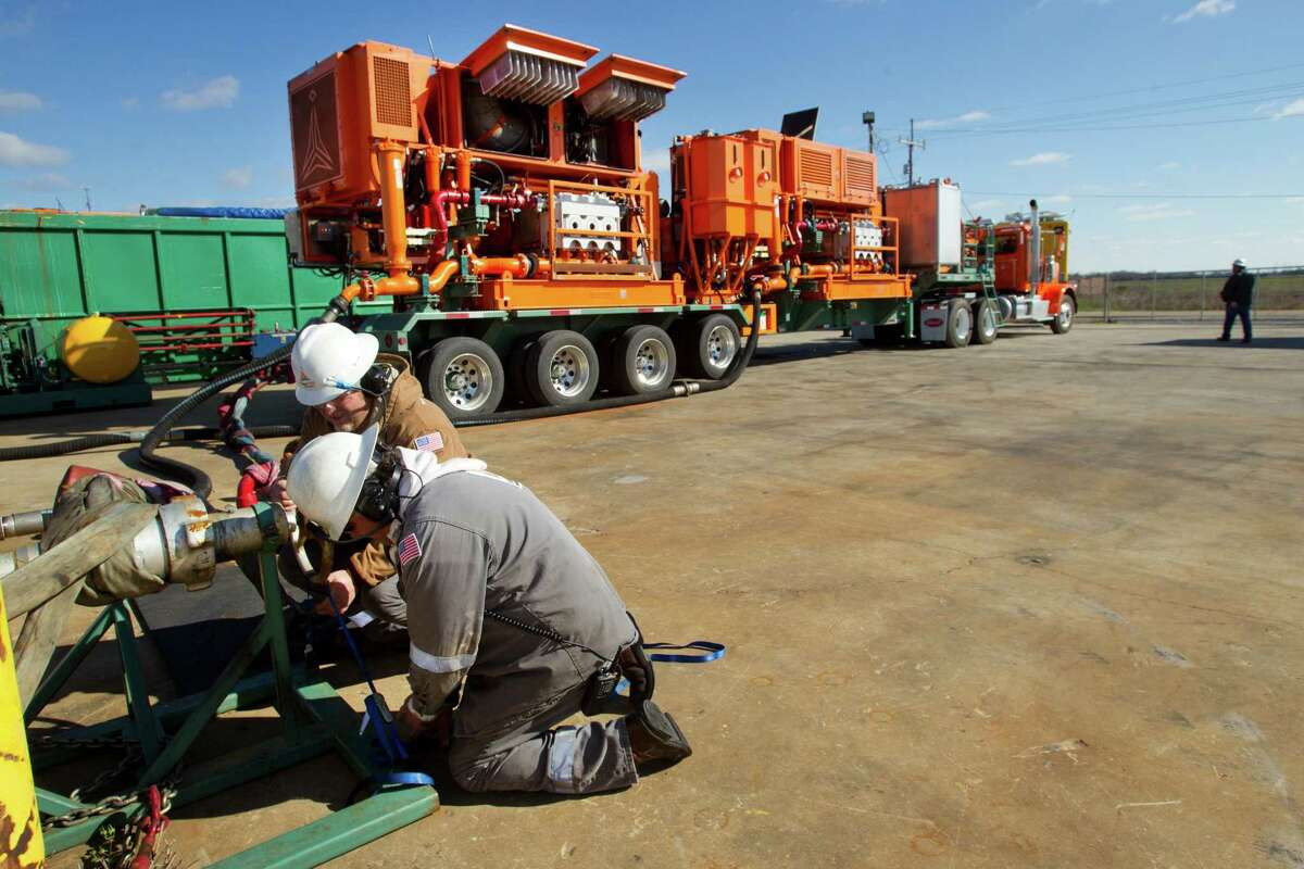Gary Boudreaux, left, and Cheries Burgess set up a test of a Green Field Energy Services turbine-powered hydraulic fracturing pump at Turbine Power Technology Tuesday, Feb. 26, 2013, in Franklin, La. ( Brett Coomer / Houston Chronicle )