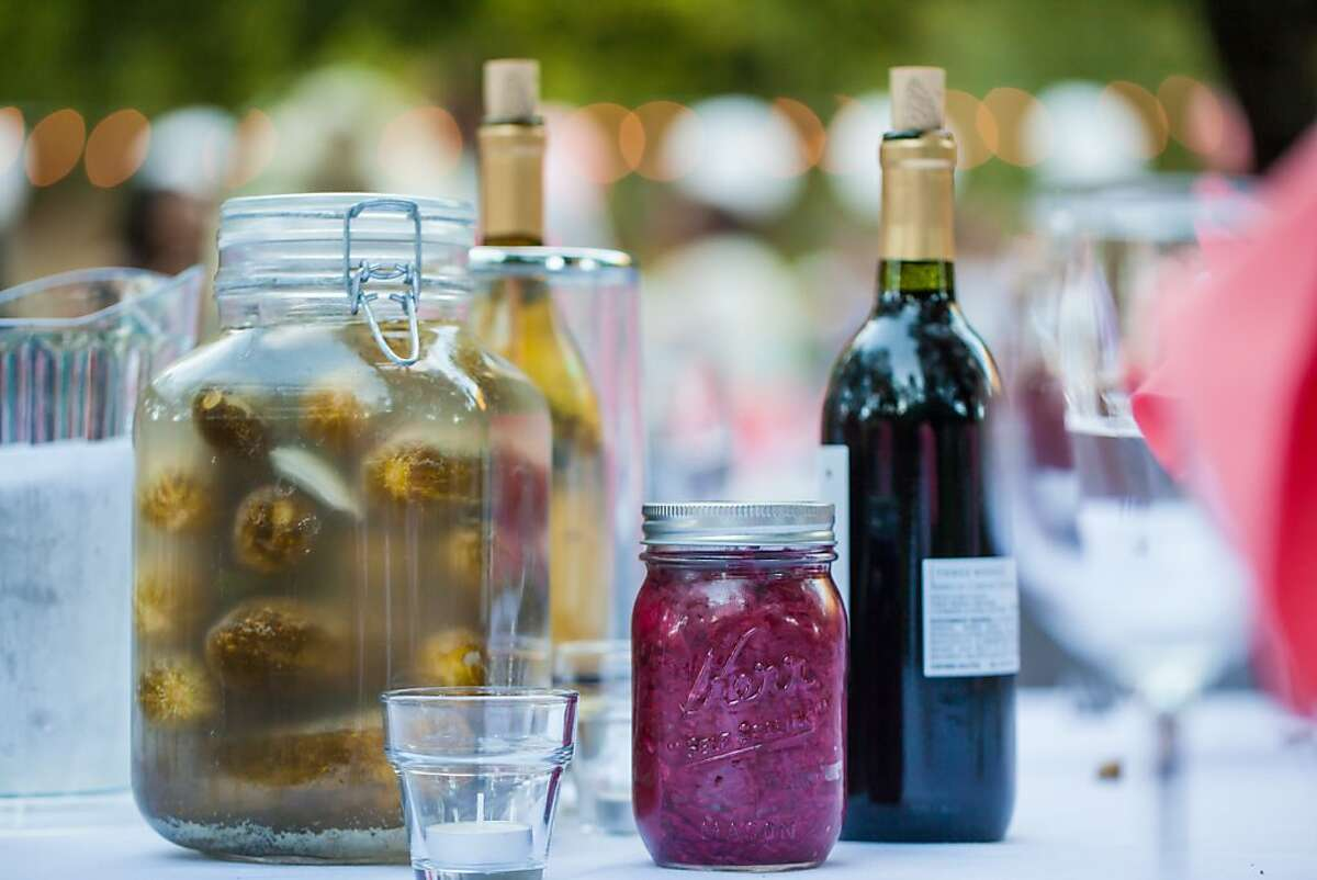 Alicia Moore and Mike Perlmutter were married Sept. 2 at Saratoga Springs Retreat Center in Upper Lake (Mendocino County). Table centerpieces were jars of Mike's homemade beet-colored sauerkraut and pickles, which guests feasted on as accompaniments to the vegetarian meal.