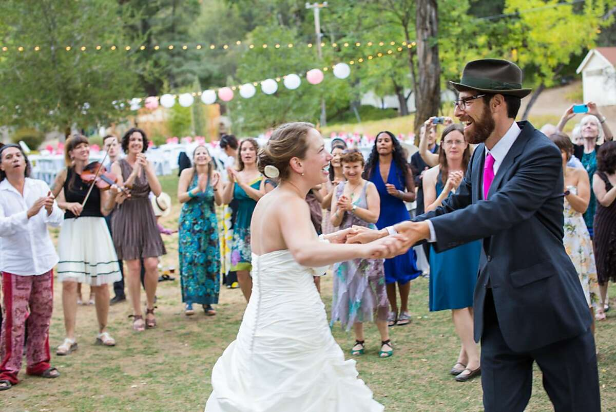 Alicia Moore and Mike Perlmutter were married Sept. 2 at Saratoga Springs Retreat Center in Upper Lake (Mendocino County). On Saturday evening, there was a slide show, cabaret, and dance party (Mike plays clarinet and alto saxophone in Inspector Gadje, a Balkan Brass Band and in a Klezmer ensemble).