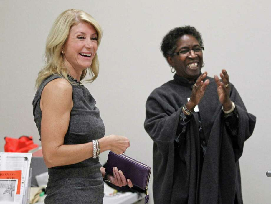 State Sen. Wendy Davis, left, visits Monday with lead clerk Melba Mackey and the staff at the Southside Community Center in east Fort Worth before she cast an early vote in Texas' Nov. 5 election. Photo: RON T. ENNIS, STF / Fort Worth Star-Telegram
