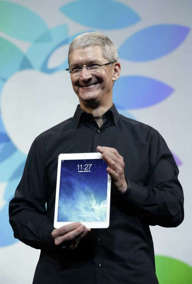 """""""We had a strong finish to an amaz- ing year,"""" Apple CEO Tim Cook told analysts."""
