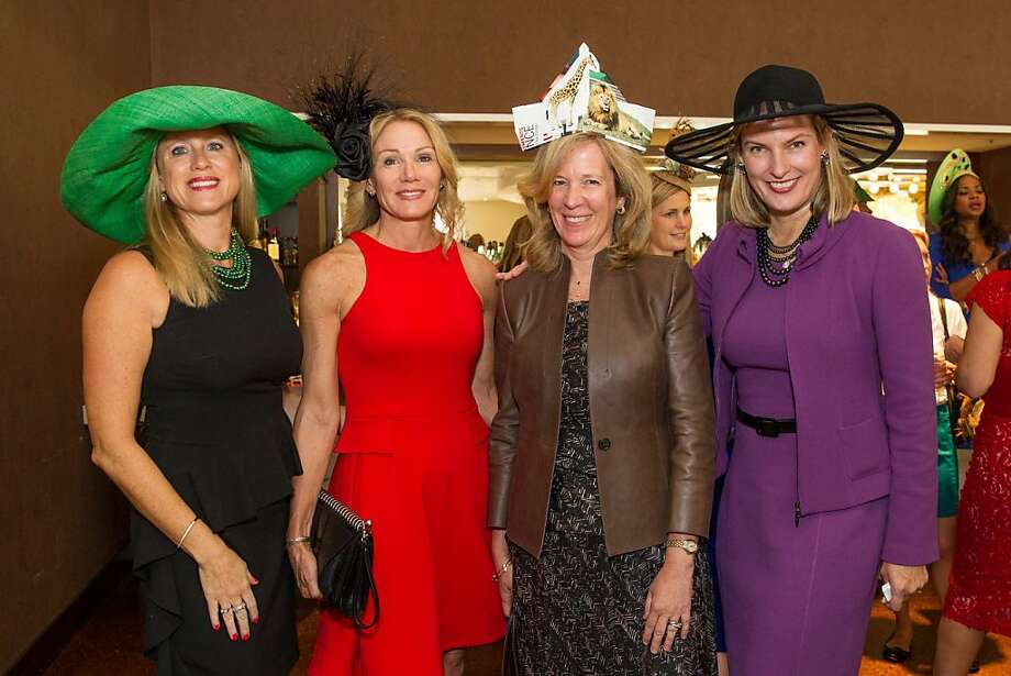Co-chair Laurie Grayson, beneath the wide green, Rosemary Baker under black feathers, paper-topped Lynn Poole, and co-chair Mindy Henderson support the San Francisco Zoo at the Birds of a Feather luncheon. Photo: Drew Altizer Photography