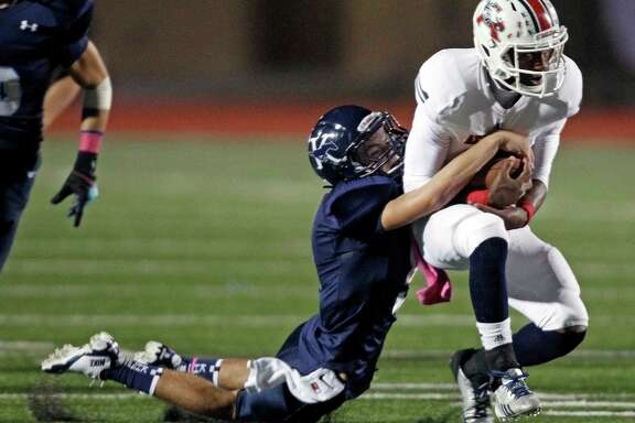 Atascocita quarterback Greg Campbell, seen here being tackled by Kingwood's Ethan Powell, has been one of the most electric players in Humble ISD this season. The dual threat Campbell has thrown 17 touchdown passes and rushed for a team-leading 790 yards to go with nine scores.
