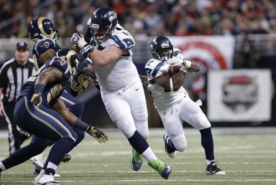 Seattle Seahawks running back Robert Turbin (22) runs against the St. Louis Rams during the first half of an NFL football game, Monday, Oct. 28, 2013, in St. Louis. (AP Photo/Michael Conroy) Photo: AP
