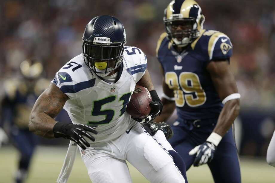 Seattle Seahawks outside linebacker Bruce Irvin (51) runs against St. Louis Rams tight end Jared Cook (89) after intercepting a pass during the first half of an NFL football game, Monday, Oct. 28, 2013, in St. Louis. (AP Photo/Michael Conroy) Photo: AP