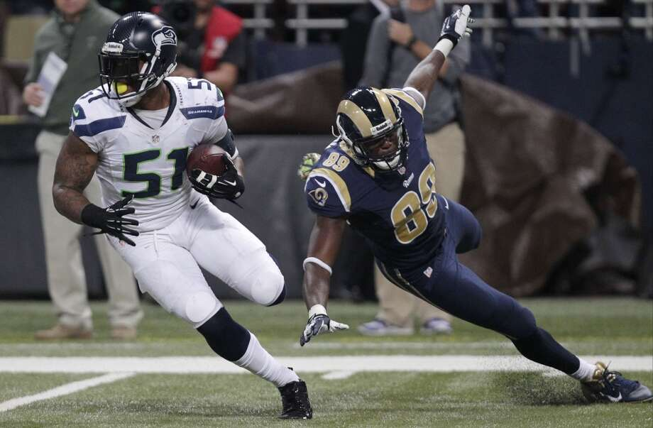 Seattle Seahawks outside linebacker Bruce Irvin (51) runs against St. Louis Rams tight end Jared Cook (89) after intercepting the pass during the first half of an NFL football game, Monday, Oct. 28, 2013, in St. Louis. (AP Photo/Tom Gannam) Photo: ASSOCIATED PRESS