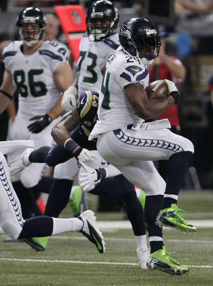Seattle Seahawks running back Marshawn Lynch (24) spins away from St. Louis Rams free safety Rodney McLeod (23) during the first half of an NFL football game, Monday, Oct. 28, 2013, in St. Louis. (AP Photo/Tom Gannam) Photo: AP