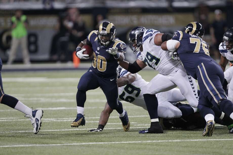 St. Louis Rams running back Zac Stacy (30) moves against the Seattle Seahawks during the first half of an NFL football game, Monday, Oct. 28, 2013, in St. Louis. (AP Photo/Tom Gannam) Photo: AP