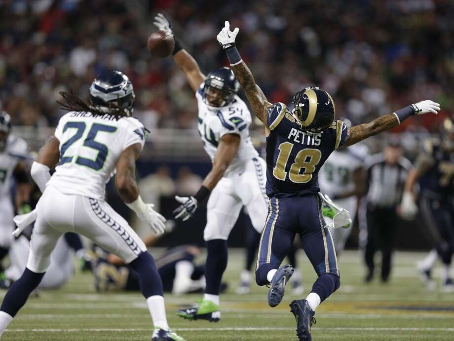 St. Louis Rams wide receiver Austin Pettis (18) cannot make a catch during the first half of an NFL football game against the Seattle Seahawks, Monday, Oct. 28, 2013, in St. Louis. Seattle Seahawks cornerback Richard Sherman (25) made the interception on the play. (AP Photo/Michael Conroy) Photo: AP