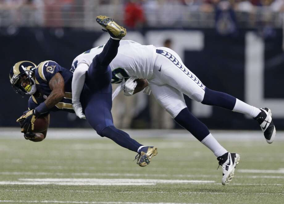 St. Louis Rams wide receiver Tavon Austin (11) gets tackled by Seattle Seahawks defensive end Cliff Avril (56) during the first half of an NFL football game, Monday, Oct. 28, 2013, in St. Louis. (AP Photo/Michael Conroy) Photo: ASSOCIATED PRESS