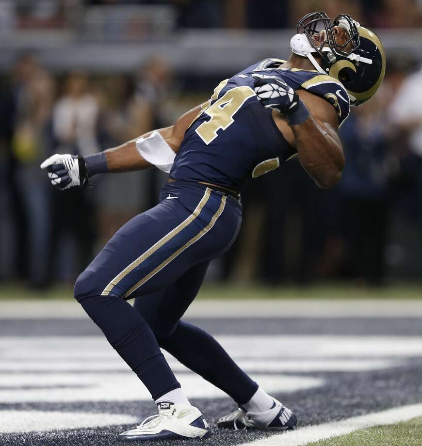 St. Louis Rams defensive end Robert Quinn (94) celebrates after sacking Seattle Seahawks quarterback Russell Wilson (3) during the first half of an NFL football game, Monday, Oct. 28, 2013, in St. Louis. (AP Photo/Michael Conroy) Photo: AP