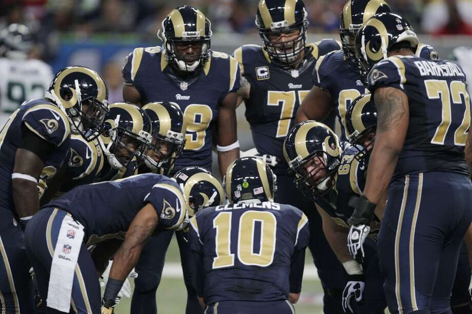 St. Louis Rams quarterback Kellen Clemens (10) speaks in the huddle against the Seattle Seahawks during the first half of an NFL football game, Monday, Oct. 28, 2013, in St. Louis. (AP Photo/Tom Gannam) Photo: AP