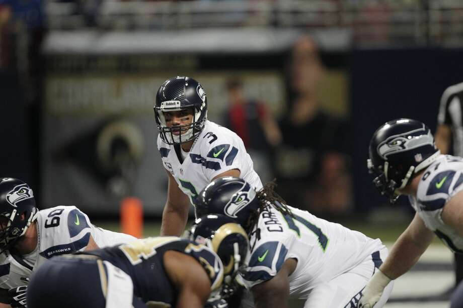 Seattle Seahawks quarterback Russell Wilson (3) works against the St. Louis Rams during the first half of an NFL football game, Monday, Oct. 28, 2013, in St. Louis. (AP Photo/Tom Gannam) Photo: AP