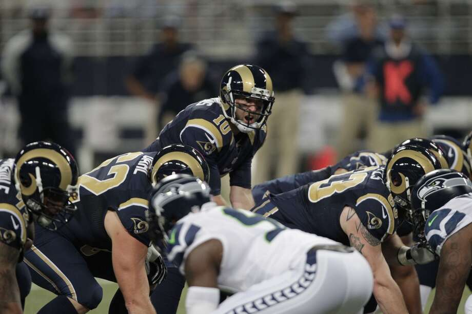 St. Louis Rams quarterback Kellen Clemens (10) works against the Seattle Seahawks during the first half of an NFL football game, Monday, Oct. 28, 2013, in St. Louis. (AP Photo/Tom Gannam) Photo: AP