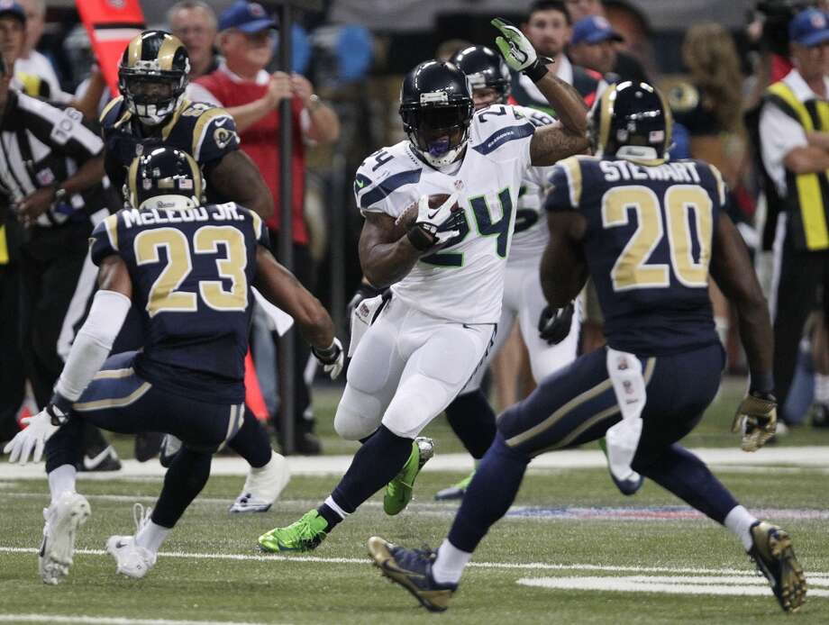 Seattle Seahawks running back Marshawn Lynch (24) rushes against St. Louis Rams strong safety Darian Stewart (20) during the first half of an NFL football game, Monday, Oct. 28, 2013, in St. Louis. (AP Photo/Tom Gannam) Photo: AP