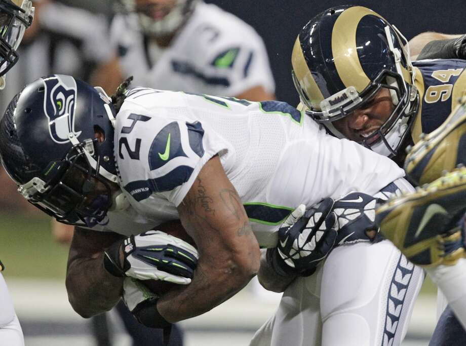 St. Louis Rams defensive end Robert Quinn (94) tackles Seattle Seahawks running back Marshawn Lynch (24) during the first half of an NFL football game, Monday, Oct. 28, 2013, in St. Louis. (AP Photo/Tom Gannam) Photo: AP
