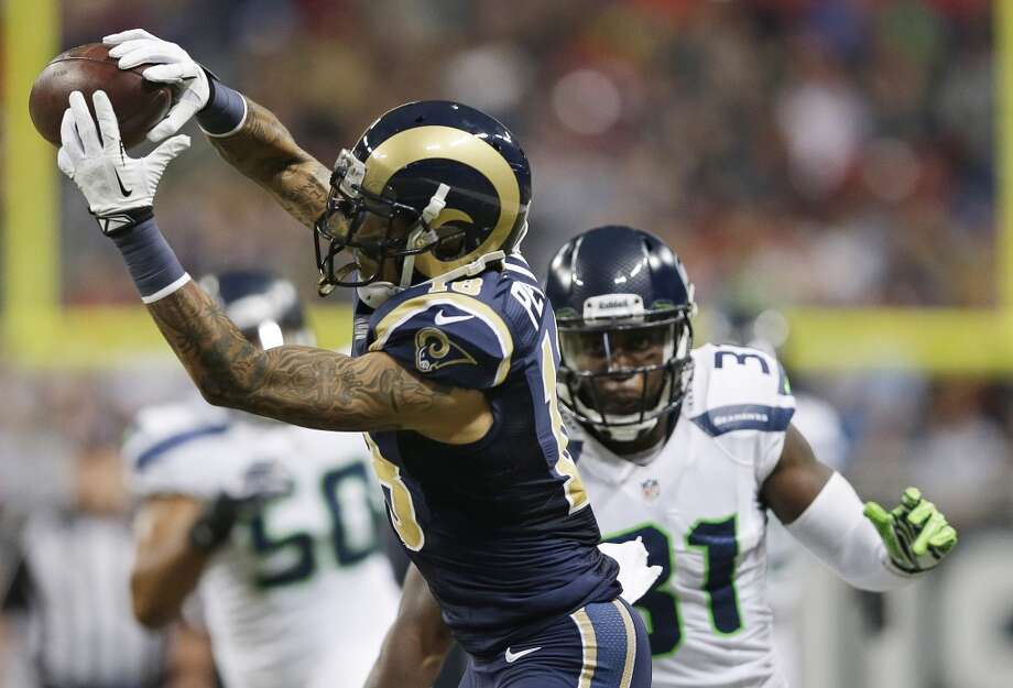 St. Louis Rams wide receiver Austin Pettis (18) makes a reception against Seattle Seahawks strong safety Kam Chancellor (31) during the first half of an NFL football game, Monday, Oct. 28, 2013, in St. Louis. (AP Photo/Michael Conroy) Photo: AP
