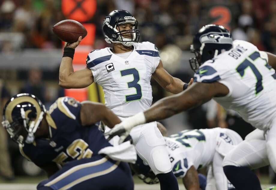 Seattle Seahawks quarterback Russell Wilson (3) works against the St. Louis Rams during the first half of an NFL football game, Monday, Oct. 28, 2013, in St. Louis. (AP Photo/Michael Conroy) Photo: AP