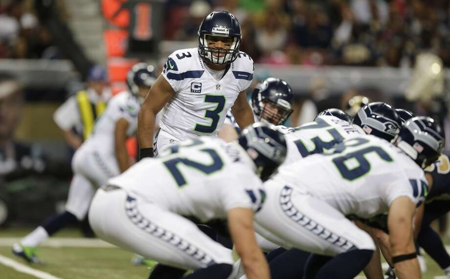 Seattle Seahawks quarterback Russell Wilson (3) works against the St. Louis Rams during the first half of an NFL football game, Monday, Oct. 28, 2013, in St. Louis. (AP Photo/Michael Conroy) Photo: ASSOCIATED PRESS