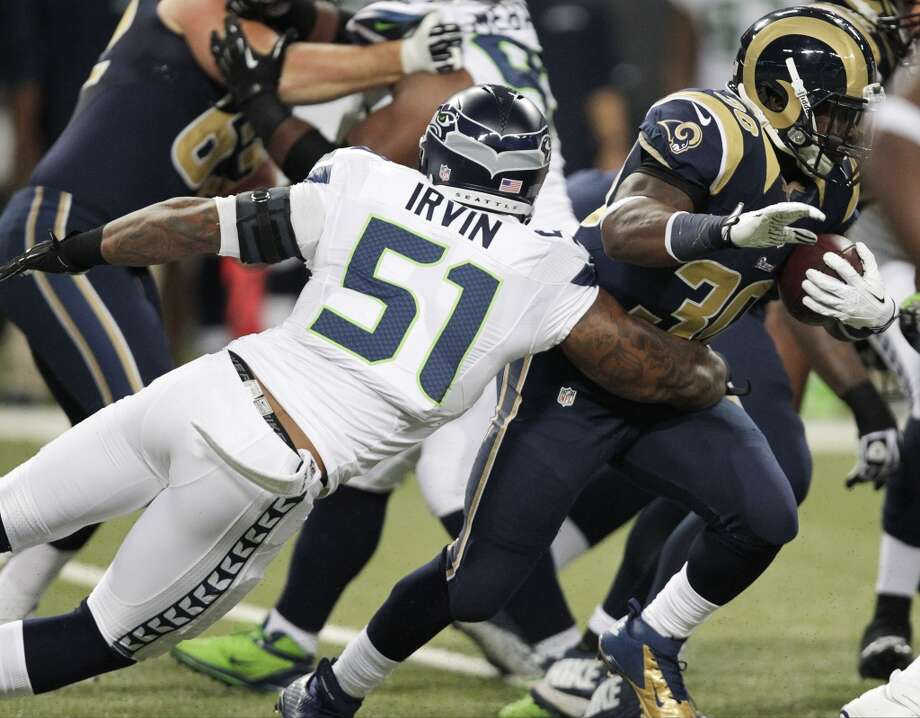Seattle Seahawks outside linebacker Bruce Irvin (51) tackles St. Louis Rams running back Zac Stacy (30) during the first half of an NFL football game, Monday, Oct. 28, 2013, in St. Louis. (AP Photo/Tom Gannam) Photo: AP