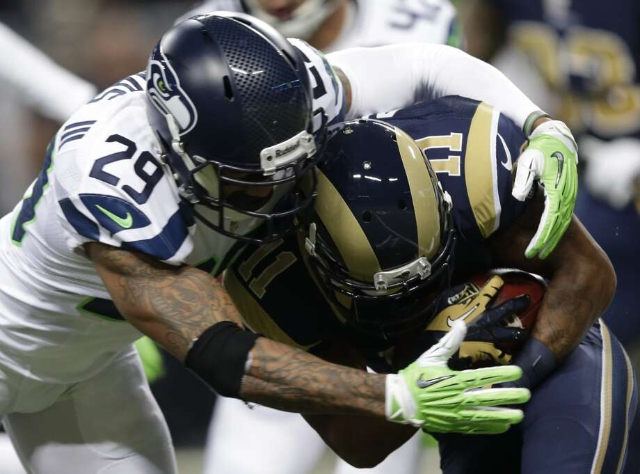 Seattle Seahawks free safety Earl Thomas (29) tackes St. Louis Rams wide receiver Tavon Austin (11) on a kickoff return during the first half of an NFL football game, Monday, Oct. 28, 2013, in St. Louis. (AP Photo/Michael Conroy) Photo: AP