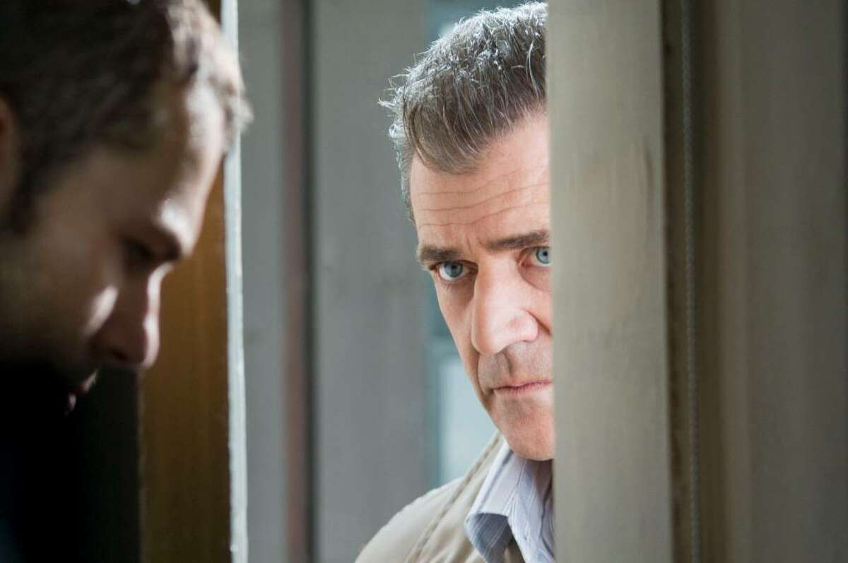 Shawn Roberts, left, as Burnham, and Mel Gibson as Thomas Craven star in Warner Bros. Pictures?' and GK Films?' suspense thriller ?