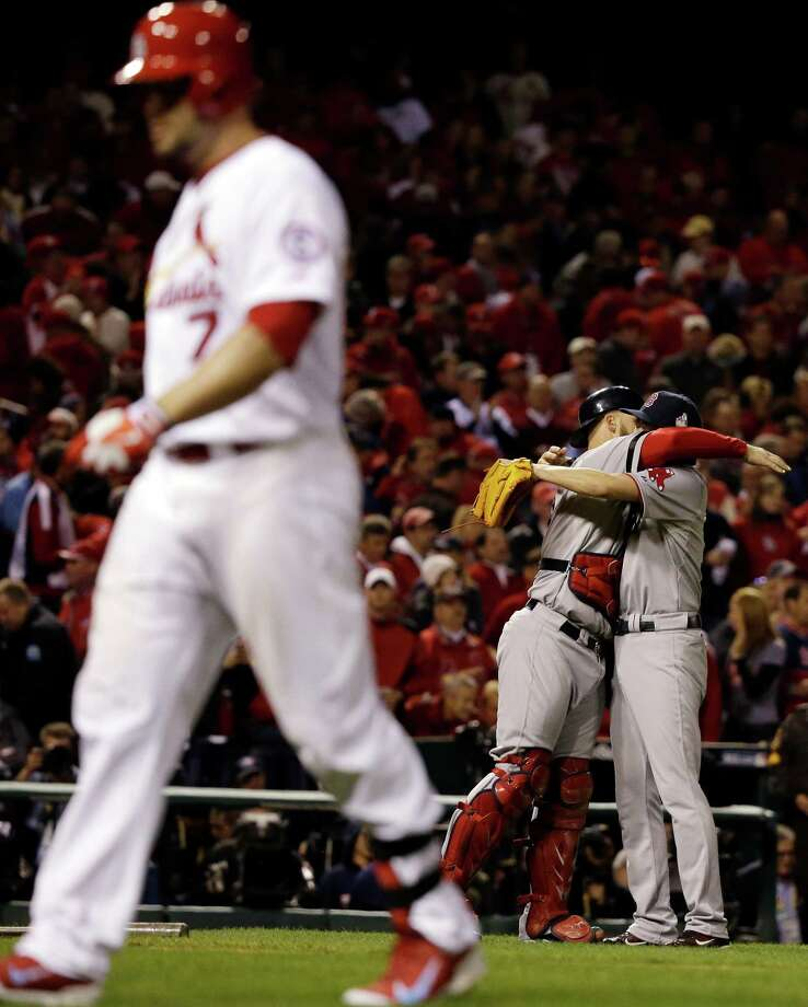 Boston Red Sox relief pitcher Koji Uehara hugs catcher David Ross after getting St. Louis Cardinals' Matt Holliday to fly out and end Game 5 of baseball's World Series Monday, Oct. 28, 2013, in St. Louis. The Red Sox won 3-1 to take a 3-2 lead in the series. (AP Photo/Jeff Roberson)  ORG XMIT: WS159 Photo: Jeff Roberson / AP