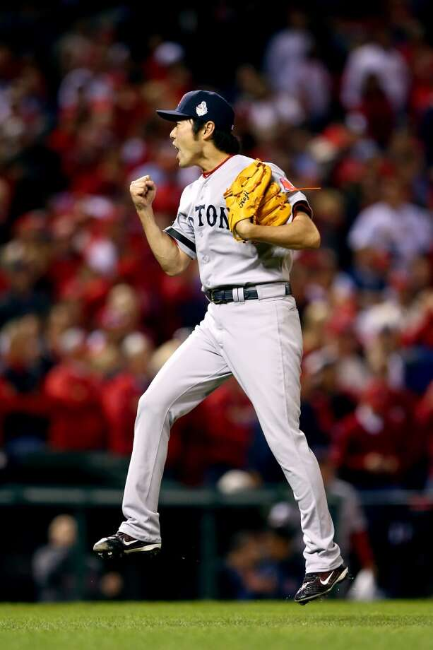 Red Sox pitcher Koji Uehara celebrates Boston's win over the Cardinals. Photo: Elsa, Getty Images