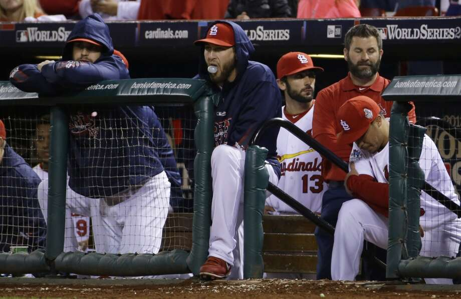 Cardinals players watch the Red Sox bat during the ninth inning. Photo: Matt Slocum, Associated Press