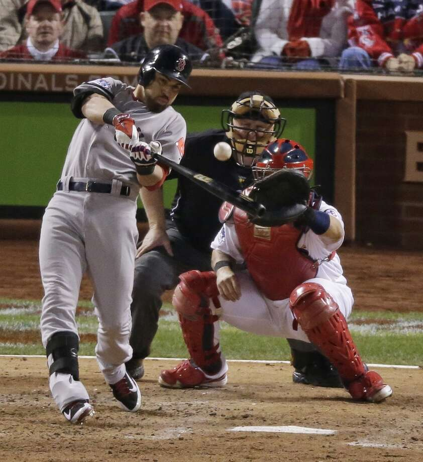 Red Sox outfielder Jacoby Ellsbury records a hit against the Cardinals. Photo: Charlie Riedel, Associated Press
