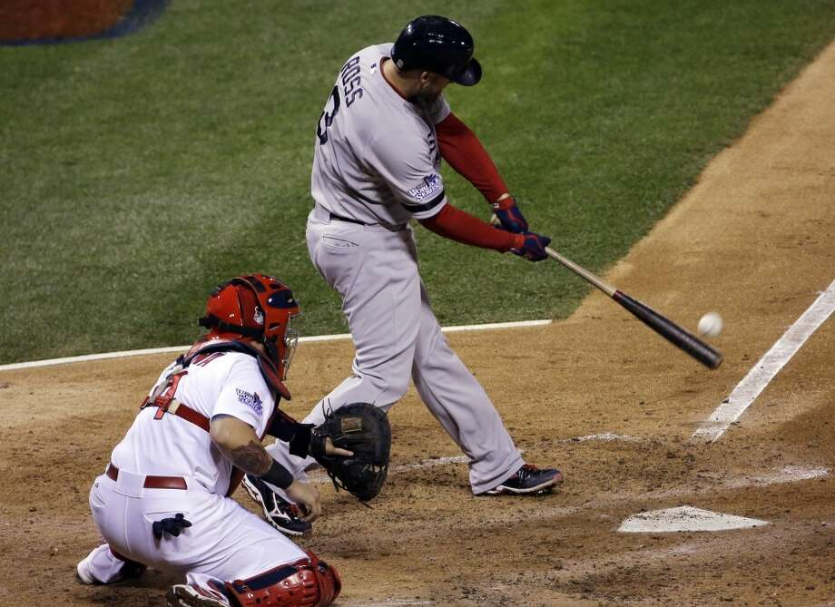 David Ross of the Red Sox hits an RBI double against the Cardinals during Game 5. Photo: David J. Phillip, Associated Press