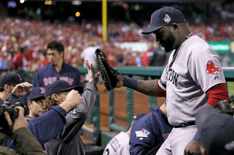 David Ortiz of the Red Sox is greeted by teammates in the dugout after being removed from Game 5 against the Cardinals. Photo: Rob Carr, Getty Images