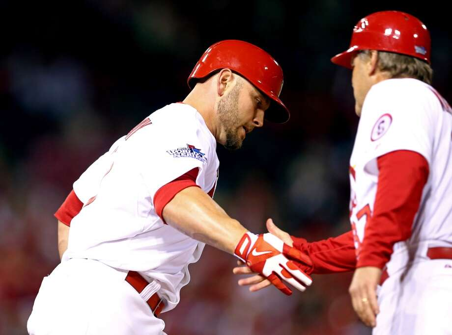 Matt Holliday of the Cardinals is congratulated after hitting a home run against the Red Sox during Game 5. Photo: Elsa, Getty Images