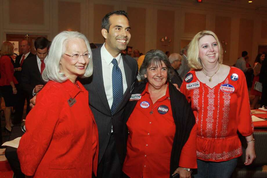 George P. Bush, candidate for Texas land commissioner, with Barbara Tague, from left, Rosalie Dillon and Carrie Whillock at the Take Back Harris County rally on Monday night. Photo: Gary Fountain, Freelance / Copyright 2013 Gary Fountain.