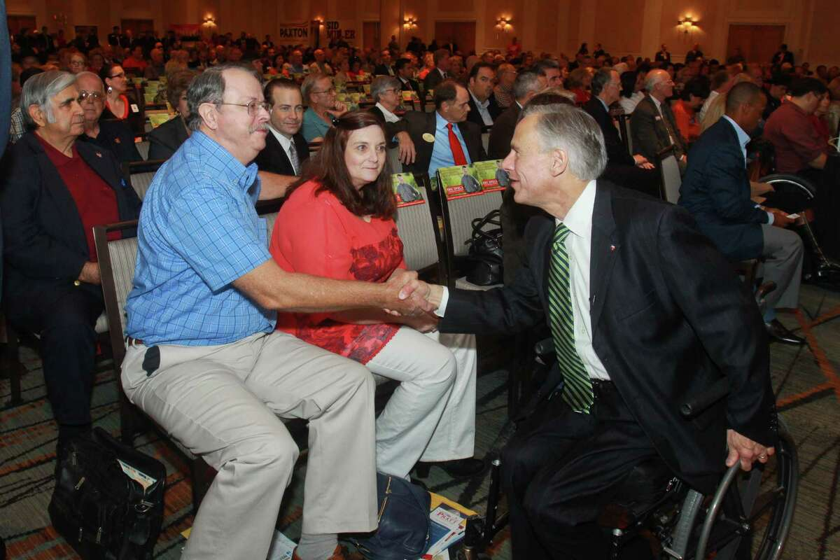 John and Denise Guenther greet Republican gubernatorial candidate Greg Abbott after he spoke at the Take Back Harris County rally on Monday night.