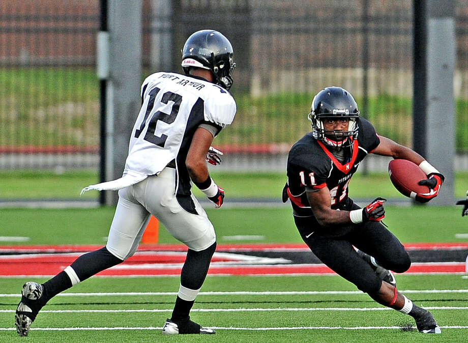 Port Arthur wide receiver Roderic Rucker, #11, charge on a punt return during the Port Arthur Memorial High School spring game on Friday, May 24, 2013, in Port Arthur. Photo taken: Randy Edwards/The Enterprise Photo: Randy Edwards